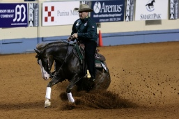 Big man, big saddle, small horse - yet one of the top reining competitors in the country, and not likely to be questioned over his weight.