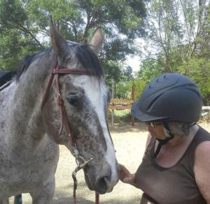 Mom having a moment with her special Appaloosa, Coffee.