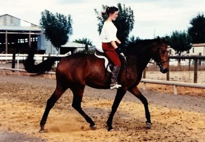 Dani, in her first year under saddle, with one of my students on board.